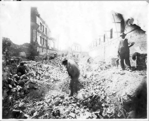 Remaining Greenwood residents sift through rubble following the riots.
